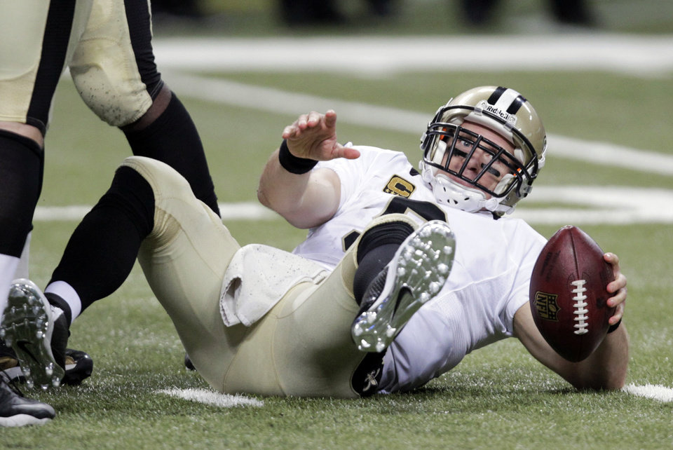 New Orleans Saints quarterback Drew Brees gets up slowly after being sacked for a 6-yard loss by St. Louis Rams defensive end William Hayes during the fourth quarter of an NFL football game Sunday, Dec. 15, 2013, in St. Louis. The Rams won 27-16. (AP Photo/Tom Gannam)
