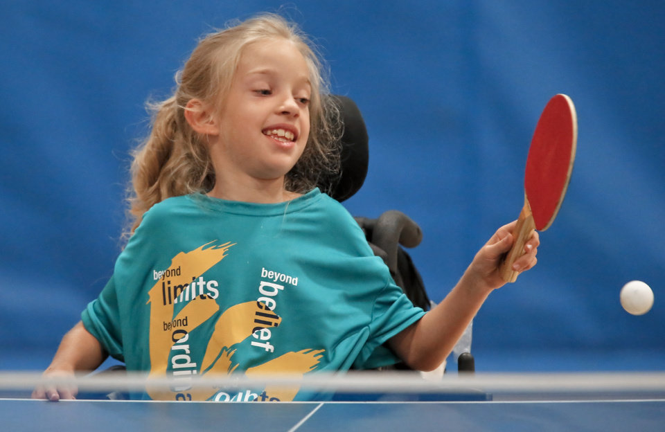 Ashley McCoy returns a serve while playing table tennis during the Endeavor Games at the University of Central Oklahoma on Friday, June 7, 2013 in Edmond, Okla.  Photo by Chris Landsberger, The Oklahoman