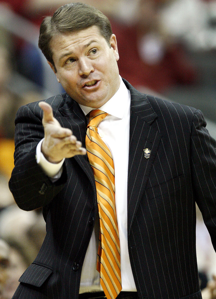 Photo - Oklahoma State coach Travis Ford calls in the play to his Cowboy's as they take on Oklahoma in the first half of the college basketball game during the men's Big 12 Championship tournament at the Sprint Center on Wednesday, March 10, 2010, in Kansas City, Mo. Photo by Chris Landsberger, The Oklahoman