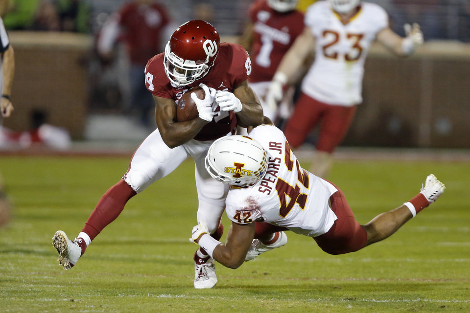 Photo - Oklahoma's Lee Morris (84) tries to get past Iowa State's Marcel Spears Jr. (42) during an NCAA football game between the University of Oklahoma Sooners (OU) and the Iowa State University Cyclones at Gaylord Family-Oklahoma Memorial Stadium in Norman, Okla., Saturday, Nov. 9, 2019. [Bryan Terry/The Oklahoman]