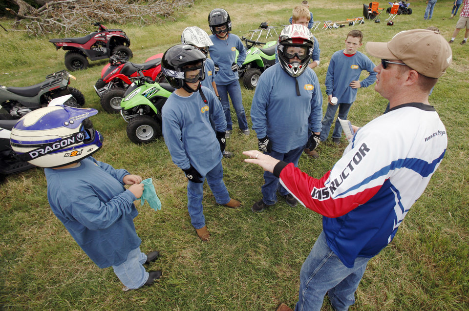 Photo - Instructor Kourtney Coats gives some instructions during a children's ATV safety course at the Logan County Fairgounds in Guthrie, OK, Friday, May 25, 2012,  By Paul Hellstern, The Oklahoman