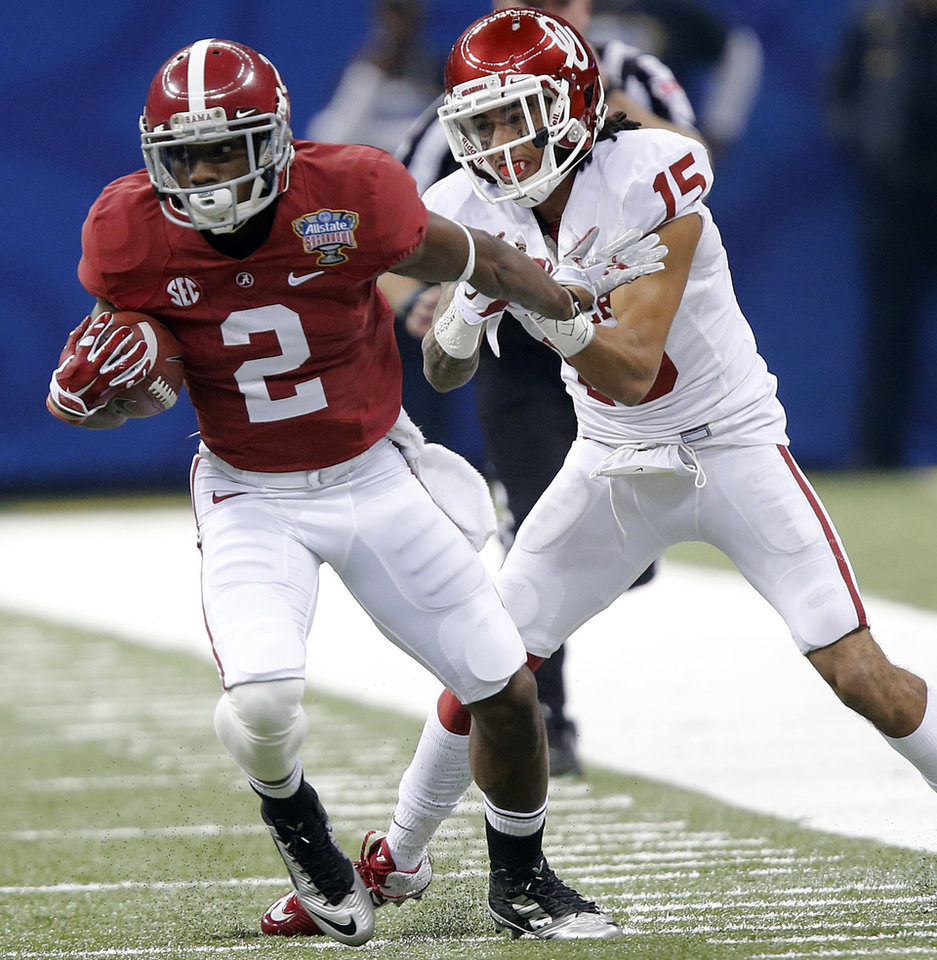 Photo - Alabama's DeAndrew White (2) gets past Oklahoma's Zack Sanchez (15) during the NCAA football BCS Sugar Bowl game between the University of Oklahoma Sooners (OU) and the University of Alabama Crimson Tide (UA) at the Superdome in New Orleans, La., Thursday, Jan. 2, 2014.  .Photo by Chris Landsberger, The Oklahoman