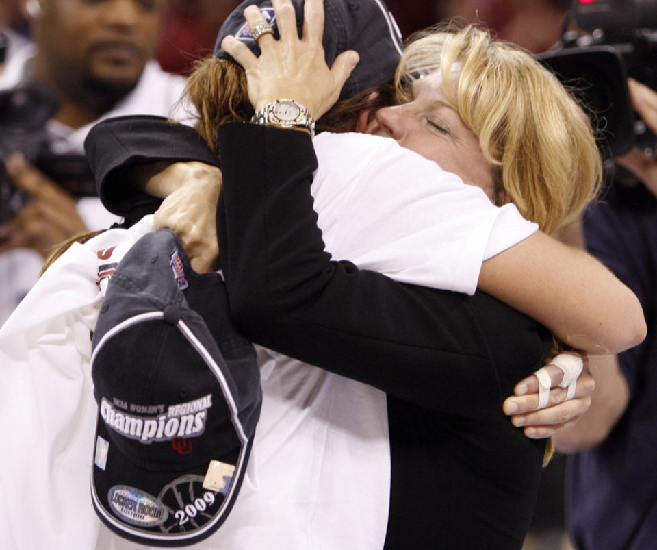 Photo - Sooner head coach Sherri Coale hugs Whitney Hand after her team's 74-68 win as the University of Oklahoma (OU) defeats Purdue in the NCAA women's basketball regional tournament finals at the Ford Center in Oklahoma City, Okla., on Tuesday, March 31, 2009.  Photo by Steve Sisney, The Oklahoman