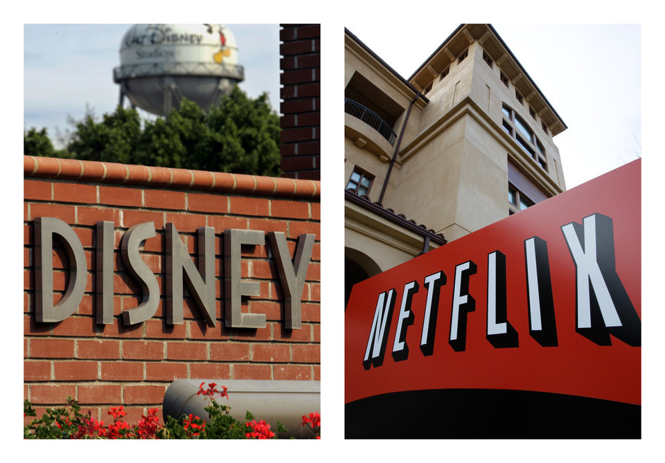 This combination of AP file photos shows the Walt Disney logo in Burbank, Calif. on June 2, 2006, and Netflix's headquarters in Los Gatos, Calif., on March 20, 2012. Netflix's video subscription service has trumped pay-TV channels and grabbed the rights on Tuesday, Dec. 4, 2012, to show Disney movies shortly after they finish their runs in theaters. (AP Photo/File)