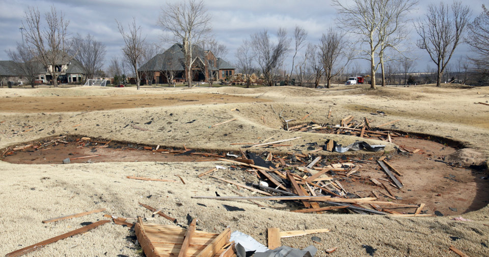 Photo - Damage to the Oak Tree golf course  on Wednesday, Feb. 11, 2009, after a tornado hit the area on Tuesday in Edmond, Okla.  PHOTO BY CHRIS LANDSBERGER, THE OKLAHOMAN