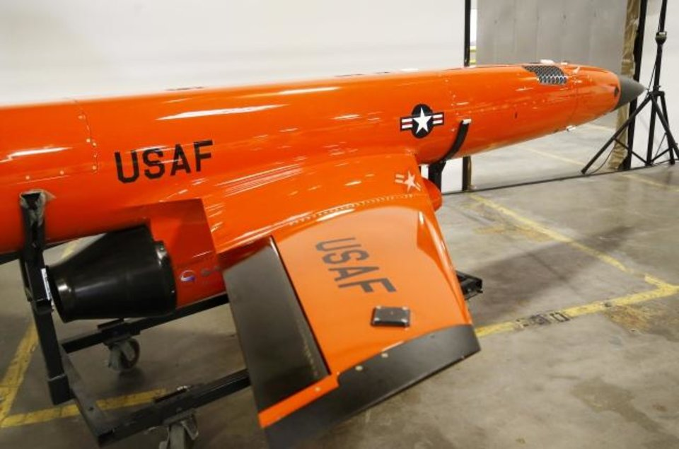 Photo -  The first combat drone produced by Kratos in Oklahoma City has rolled off the line and on Wednesday was introduced to government officials at the company's production facility in southwest Oklahoma City. [JIM BECKEL/THE OKLAHOMAN]