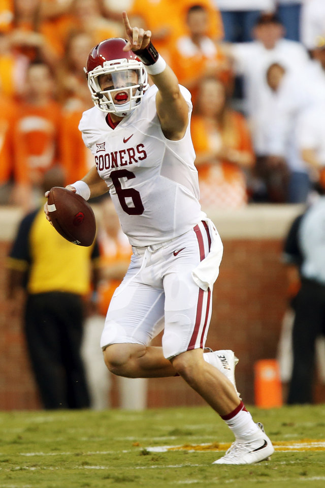 Photo - Oklahoma's Baker Mayfield (6) signals a receiver before throwing the ball away during the college football game between the Oklahoma Sooners (OU) and the Tennessee Volunteers at Neyland Stadium in Knoxville, Tennessee, Saturday, Sept. 12, 2015. Photo by Nate Billings, The Oklahoman