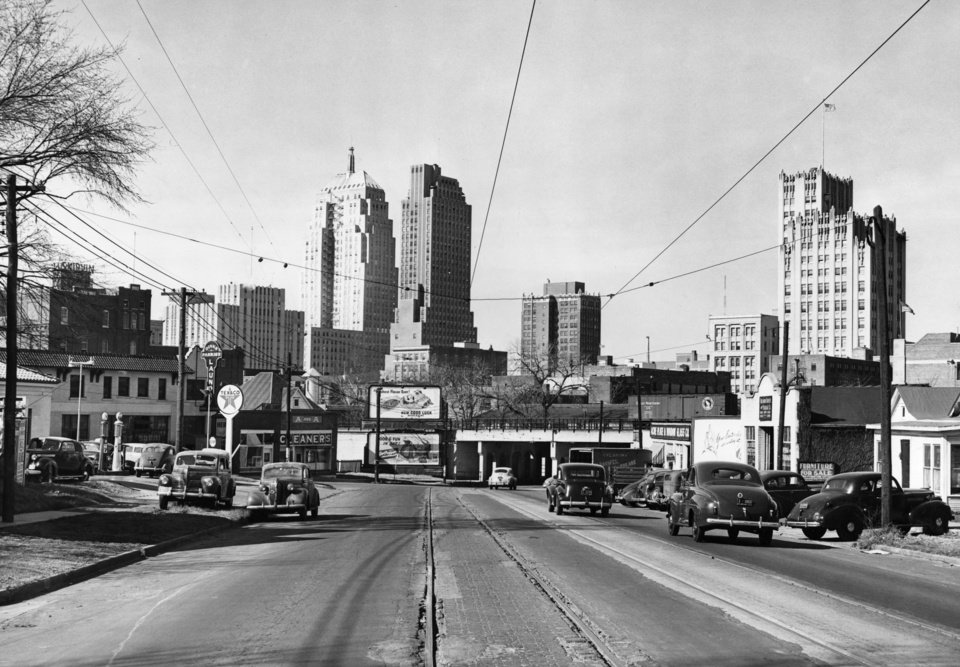 OKLAHOMA CITY / SKY LINE / OKLAHOMA:  4th Street & Harrison - 1945.  Photo undated and unpublished.  Photo arrived in library on 04/03/1945.