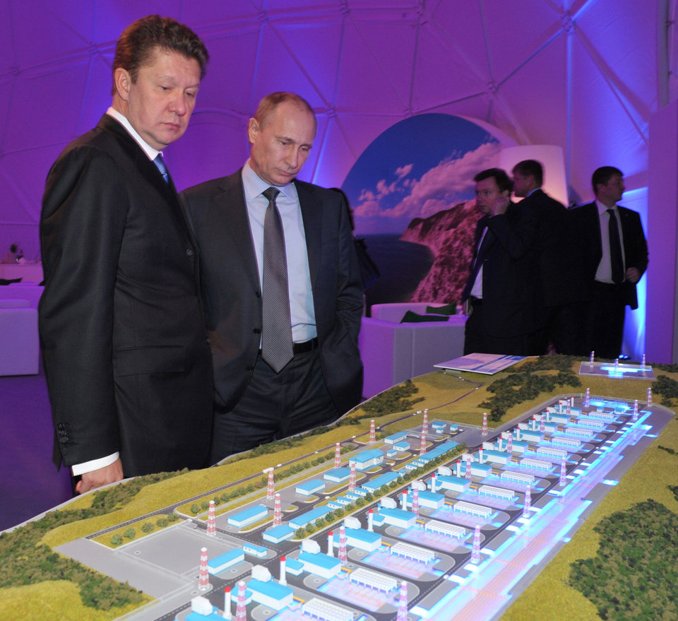 Russian President Vladimir Putin and Russian gas monopoly Gazprom Head Alexei Miller, left, look at a model of a facility before a launching ceremony of the construction of South Stream pipeline in the Black Sea resort of Anapa, southern Russia, Friday, Dec. 7, 2012. After years of delays and negotiations, Russian gas company Gazprom on Friday formally started construction of its Europe-bound South Stream pipeline, key to its strategy of eliminating shipping risks by bypassing transit nations like Ukraine. (AP Photo/RIA-Novosti, Alexei Nikolsky, Presidential Press Service)