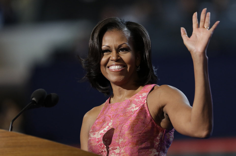 Photo - First Lady Michelle Obama waves to delegates at the Democratic National Convention in Charlotte, N.C., on Monday, Sept. 3, 2012. (AP Photo/David Goldman)  ORG XMIT: DNC802