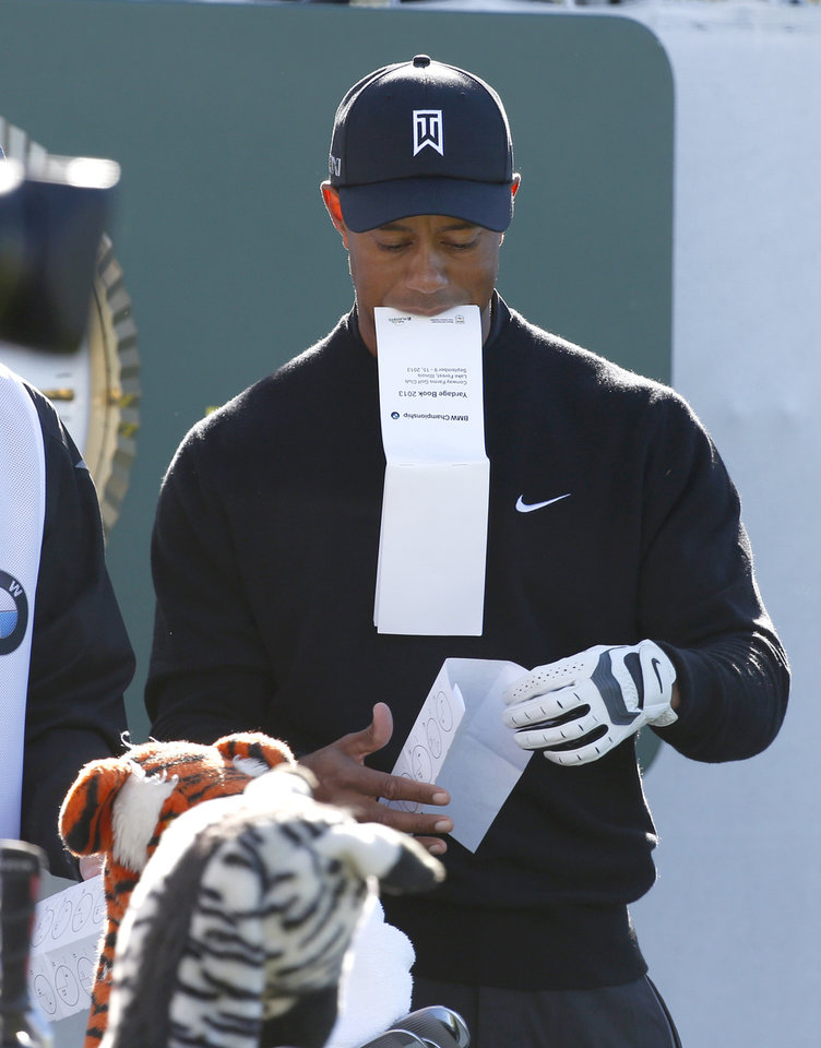 Photo - Tiger Woods prepares on the first tee for the final round of the BMW Championship golf tournament at Conway Farms Golf Club in Lake Forest, Ill., Monday, Sept. 16, 2013. (AP Photo/Charles Rex Arbogast)
