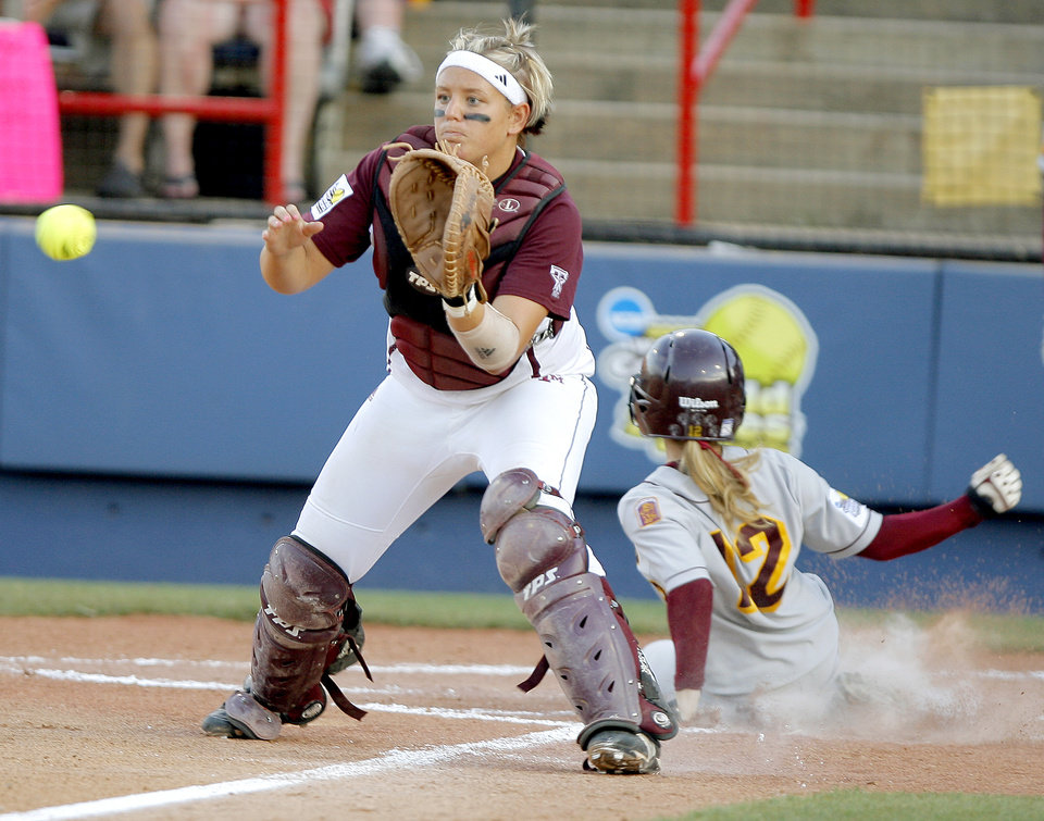Photo - COLLEGE SOFTBALL: Texas A&M's Erin Glasco waits for the ball as Arizona State's Jessica Mapes scores in the third inning of  the second championship game of the Women's College World Series between Texas A&M University and Arizona State University at ASA Hall of Fame Stadium in Oklahoma City, Tuesday, June 3, 2008. BY BRYAN TERRY, THE OKLAHOMAN ORG XMIT: KOD