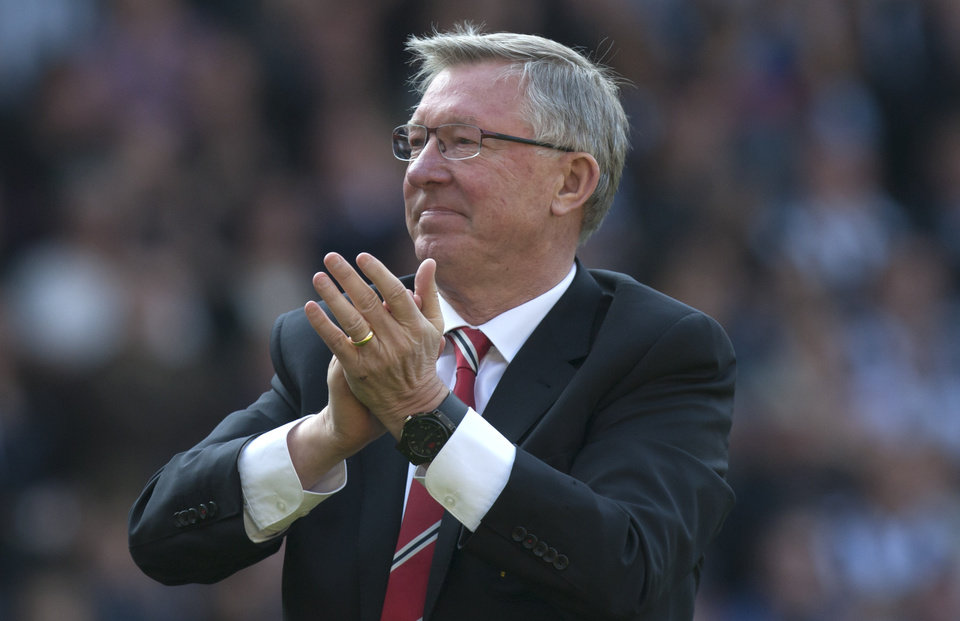 Manchester United manager Sir Alex Ferguson applauds supporters after his last game in charge of his team, their English Premier League soccer match against West Bromwich Albion at The Hawthorns Stadium, West Bromwich, England, Sunday May 19, 2013. (AP Photo/Jon Super)