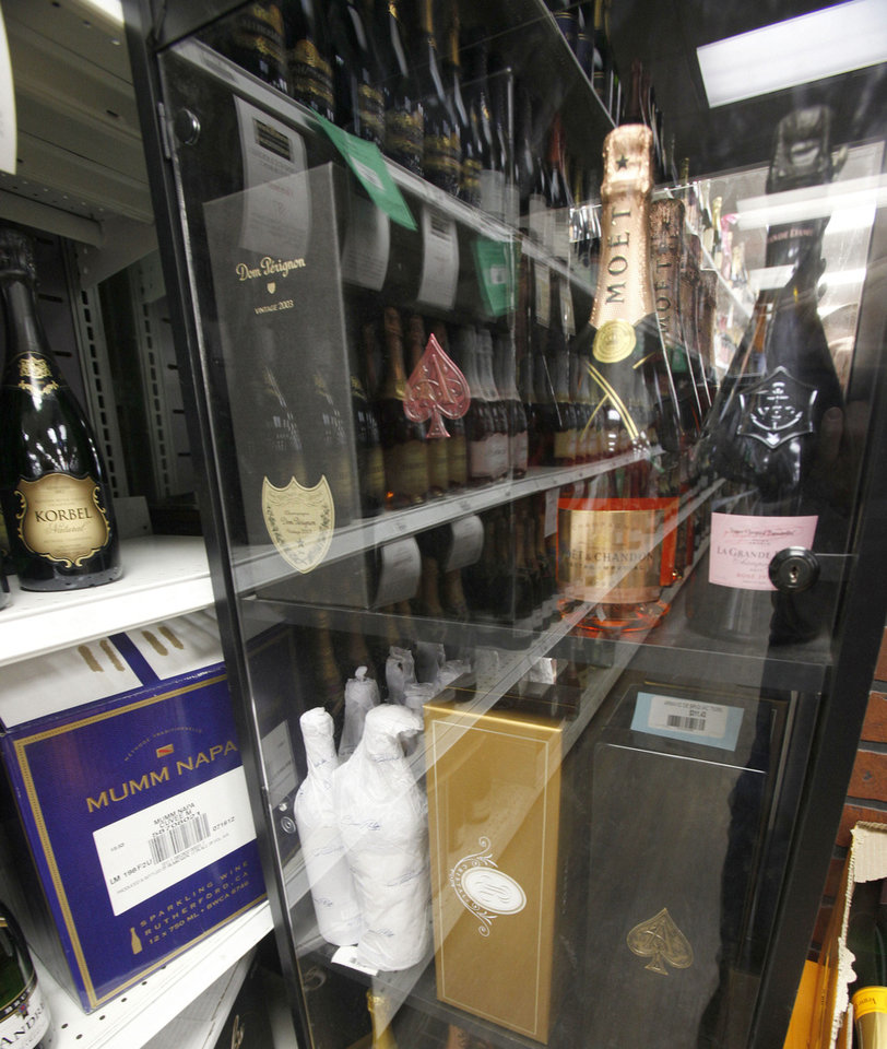 High-end bottles of Champagne, some costing upwards of $250 a bottle, await customers at Byron's Liquor Warehouse.