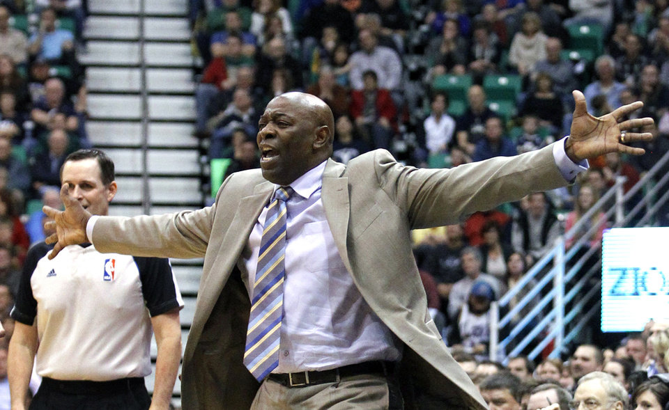 Photo - Sacramento Kings head coach Keith Smart shouts to his team in fourth quarter during an NBA basketball game against the Utah Jazz, Monday, Feb. 4, 2013, in Salt Lake City. The Jazz defeated the Sacramento Kings 98-91 in overtime. (AP Photo/Rick Bowmer)