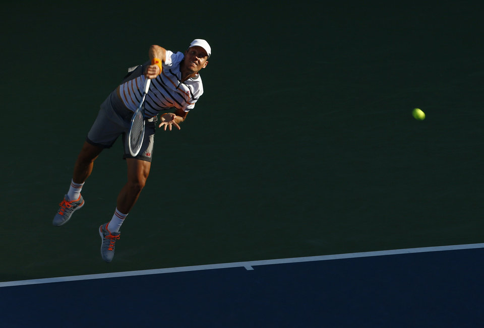 Photo - Tomas Berdych, of the Czech Republic, serves against  Martin Klizan, of Slovakia, during the second round of the 2014 U.S. Open tennis tournament, Friday, Aug. 29, 2014, in New York. (AP Photo/Matt Rourke)