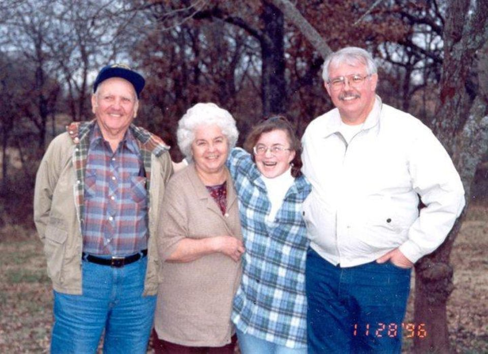 Cathy Byus seen in a 1996 photograph with her father and grandparents.  Photo provided