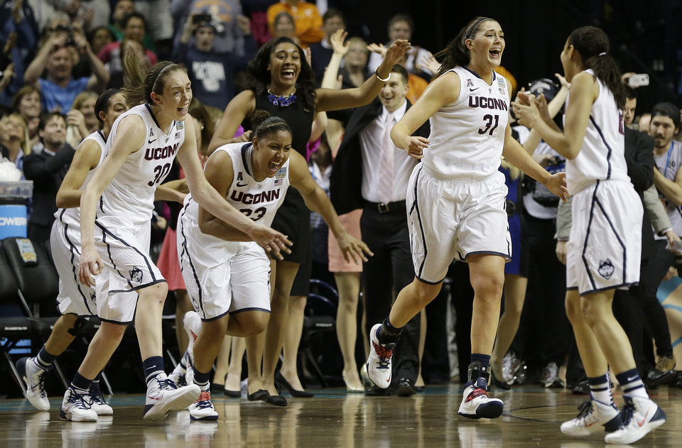 Photo - Connecticut players leave the bench after the second half of the championship game against Notre Dame in the Final Four of the NCAA women's college basketball tournament, Tuesday, April 8, 2014, in Nashville, Tenn. Connecticut won 79 -58. (AP Photo/Mark Humphrey)