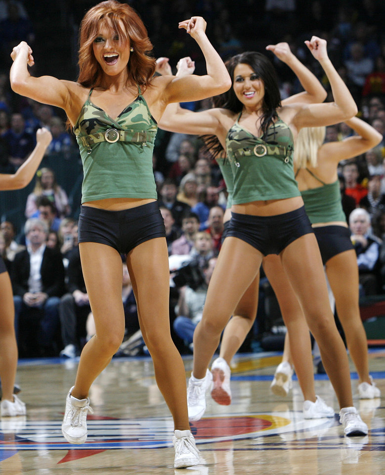 Photo - The Thunder Girls perform during the NBA basketball game between the Oklahoma City Thunder and the New York Knicks at the Ford Center in Oklahoma City, January 11, 2010. Photo by Nate Billings, The Oklahoman