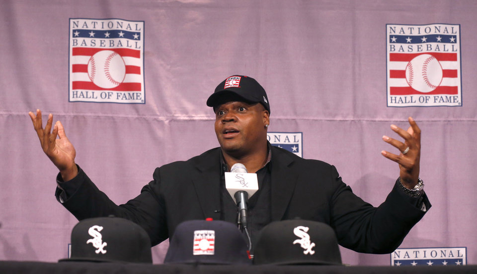 Photo - Chicago White Sox slugger Frank Thomas gestures  during a news conference about his selection into the MLB Baseball Hall Of Fame Wednesday, Jan. 8, 2014, at U.S. Cellular Field in Chicago. Thomas joins Greg Maddux and Tom Glavine as first ballot inductees Wednesday, and will be inducted in Cooperstown on July 27 along with managers Bobby Cox, Joe Torre and Tony La Russa, elected last month by the expansion-era committee. (AP Photo/Charles Rex Arbogast)