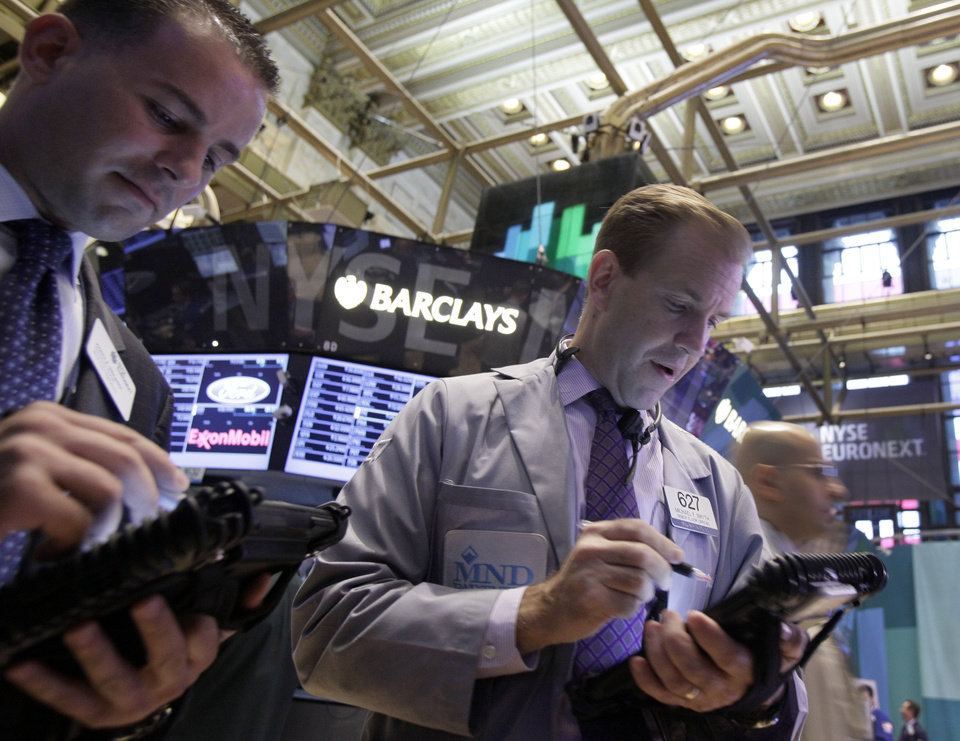 Photo -   Traders work on the floor of the New York Stock Exchange Friday, Sept. 7, 2012. Stocks are opening mixed on Wall Street following news that the U.S. economy added fewer jobs than expected in August. (AP Photo/Richard Drew)