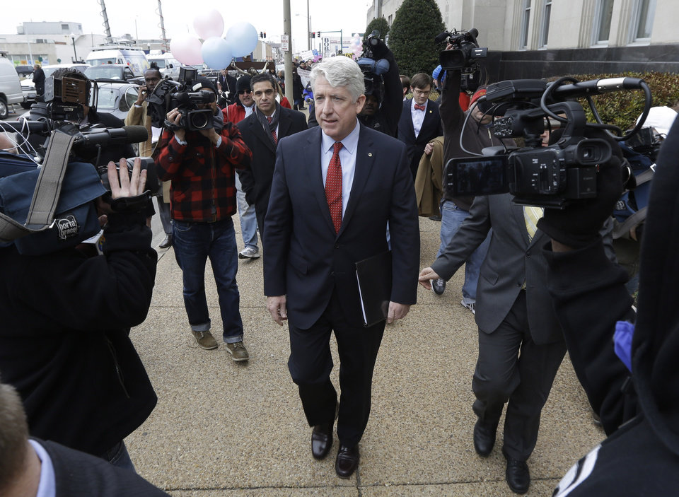 Photo - Virginia Attorney General Mark Herring leaves Federal Court after a hearing on Virginia's ban on gay marriage in Norfolk, Va., Tuesday, Feb. 4, 2014.  Herring the state's newly elected Democratic attorney general has already decided to side with the plaintiffs and will not defend the ban.  (AP Photo/Steve Helber)