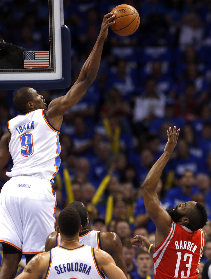 Photo - Oklahoma City's Serge Ibaka (9) blocks the shot of Houston's James Harden (13) during Game 1 in the first round of the NBA playoffs between the Oklahoma City Thunder and the Houston Rockets at Chesapeake Energy Arena in Oklahoma City, Sunday, April 21, 2013. Photo by Sarah Phipps, The Oklahoman