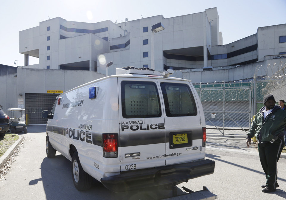 Photo - A prisoner transport van believed to be carrying pop star Justin Bieber arrives at the Turner Guilford Knight Correctional Center, Thursday, Jan. 13, 2014, in Miami. Bieber and R&B singer Khalil were arrested early Thursday for allegedly drag racing on a Miami Beach Street. Police say Bieber failed a field sobriety test. (AP Photo/Lynne Sladky)