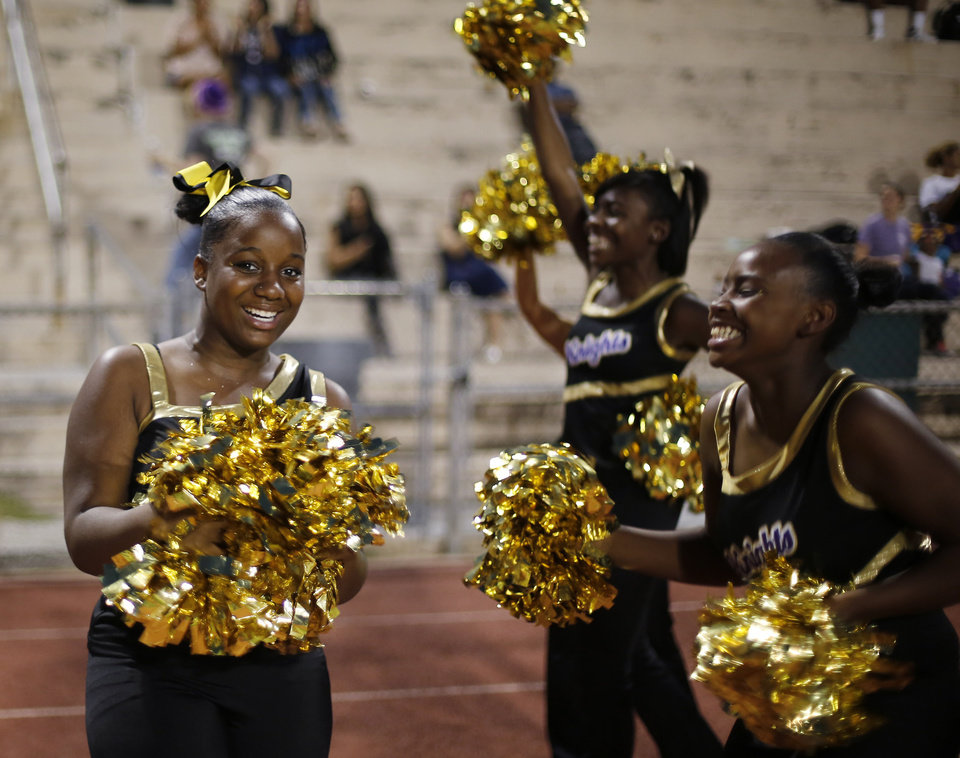 NWC cheer squad reacts to a Knight touchdown at the Northwest Classen vs. Western Heights high school football game at Taft Stadium Thursday, September 20, 2012. Photo by Doug Hoke, The Oklahoman