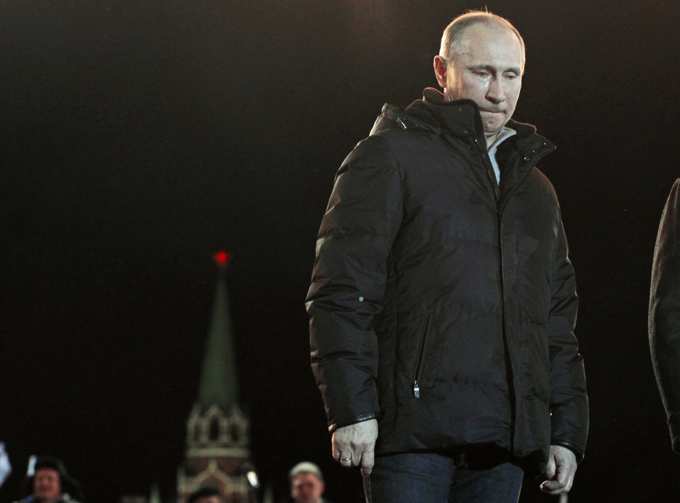 Photo -   In this Sunday, March 4, 2012 file photo, Russian Prime Minister Vladimir Putin has tears in his eyes as he reacts at a massive rally of his supporters during presidential election at Manezh square outside the Kremlin, in Moscow. Vladimir Putin's return to the presidency on Monday May 7, 2012 will technically give him greater powers than he wielded as prime minister. The irony is that his position will be arguably weaker than at any time since he first came to power more than 12 years ago. (AP Photo/Ivan Sekretarev)
