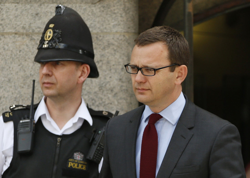 Photo - Andy Coulson, former News of the World editor and the former spin doctor of British Prime Minister David Cameron, leaves the Central Criminal Court in London, Wednesday, June 25, 2014. Coulson was convicted of phone hacking Tuesday, but fellow editor Rebekah Brooks was acquitted after a monthslong trial centering on illegal activity at the heart of Rupert Murdoch's newspaper empire. A judge on Wednesday dismissed the jury at Britain's phone-hacking trial after it failed to reach a verdict on two final counts, having convicted him of hacking a day earlier. Judge John Saunders ended the trial after jurors said they could not agree whether Coulson and ex-royal editor Clive Goodman were guilty of paying police officers for royal phone directories. Prosecutors said they would announce next week whether they would seek a retrial. (AP Photo/Lefteris Pitarakis)
