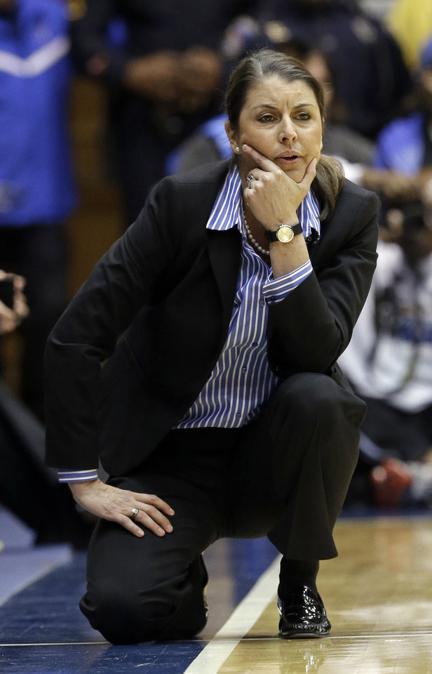 Photo - Duke coach Joanne P. McCallie watches her team during the second half of an NCAA college basketball game against North Carolina in Durham, N.C., Monday, Feb. 10, 2014. North Carolina won 89-78. (AP Photo/Gerry Broome)