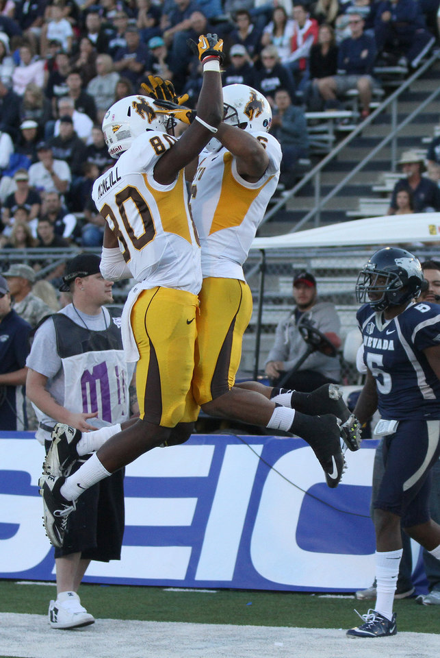 Photo -   Wyoming's Robert Herron (6) celebrates his touchdown reception with Chris McNeill (80) during the first half of an NCAA college football game in Reno, Nev., on Saturday, Oct. 6, 2012. (AP Photo/Cathleen Allison)
