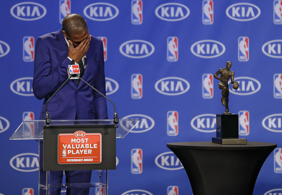 Oklahoma City Thunder's Kevin Durant wipes the tears from his eyes during a news conference announcing Durant as the winner of the 2013-14 Kia NBA Basketball Most Value Player Award in Oklahoma City, Okla. on Tuesday, May 6, 2014. PHOTO BY CHRIS LANDSBERGER, The Oklahoman
