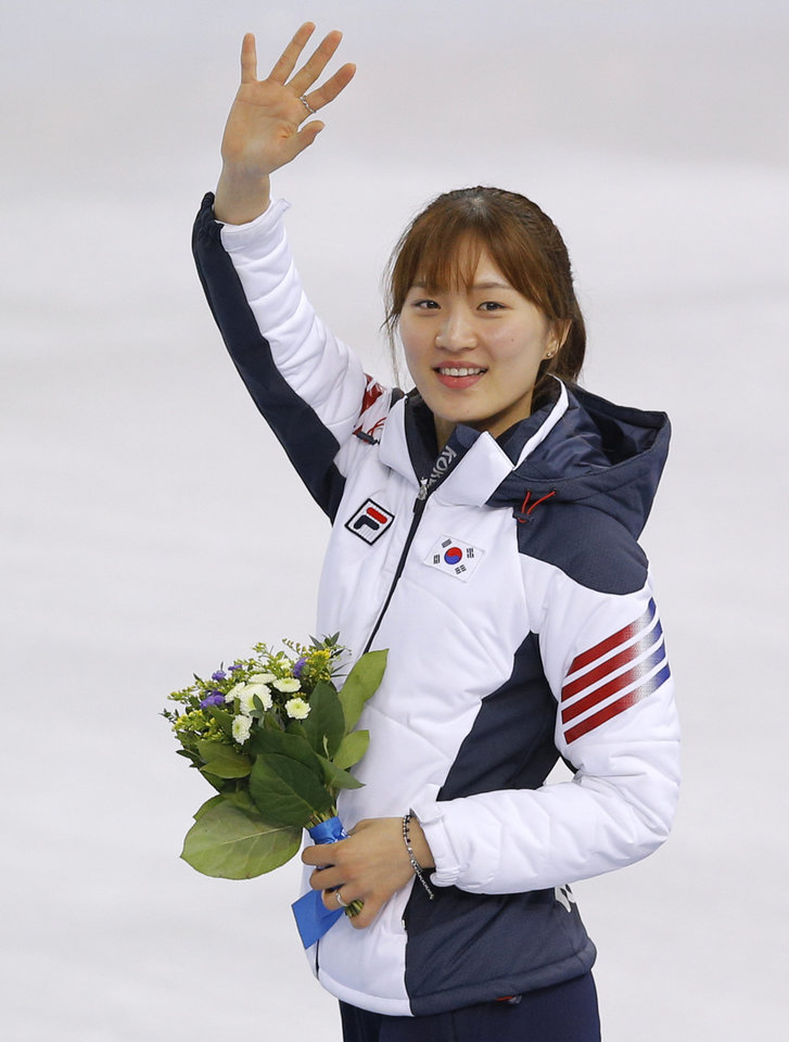 Photo - Park Seung-hi of South Korea celebrates her first place as she stands on the podium during the flower ceremony for the women's 1000m short track speedskating final at the Iceberg Skating Palace during the 2014 Winter Olympics, Friday, Feb. 21, 2014, in Sochi, Russia. (AP Photo/Vadim Ghirda)
