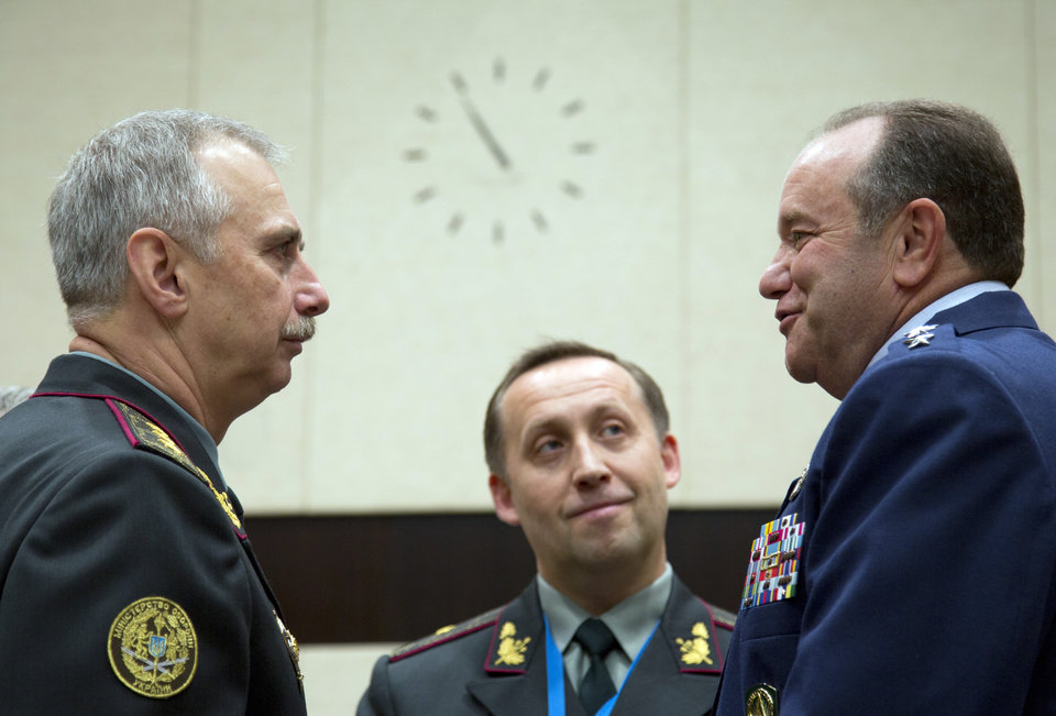 Photo - NATO's Supreme Allied Commander Europe U.S. General Philip M. Breedlove, right, speaks with Ukraine's acting Defense Minister Mykhailo Koval, left, during a meeting of NATO defense ministers in the format of the North Atlantic Council with Non-ISAF contributing Nations at NATO headquarters in Brussels on Wednesday, June 4, 2014.  (AP Photo/Virginia Mayo)
