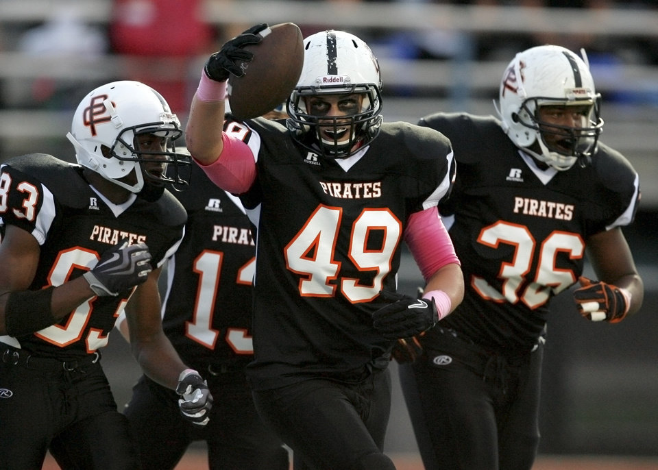 Photo - Putnam City's Zach Moore celebrates a touchdown during a high school football game between Putnam City and Choctaw in Oklahoma CIty, Thursday, September 16,  2010.  Photo by Bryan Terry, The Oklahoman