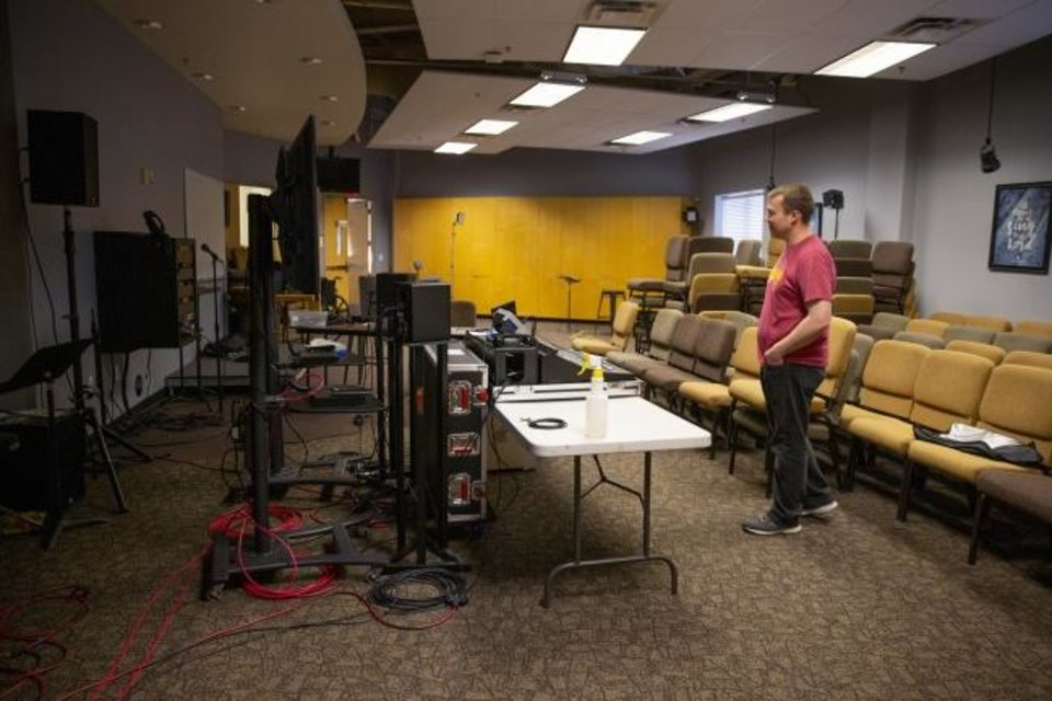 Photo -  Michael Scott, director of media arts at Henderson Hills Baptist Church, stands inside a makeshift audio control room in Edmond, Okla., Thursday, April 9, 2020. Henderson Hills Baptist Church will livestream their Easter service. [Bryan Terry/The Oklahoman]