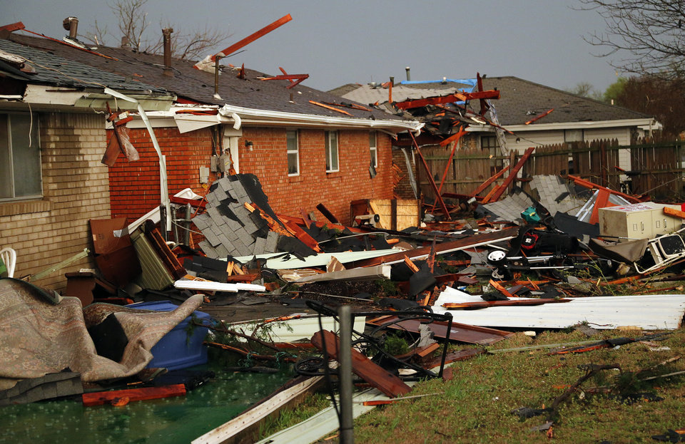 Photo - Storm damage near NW 1st and Norman after a tornado hit in Moore, Okla. on Wednesday, March 25, 2015.  Photo by Chris Landsberger, The Oklahoman