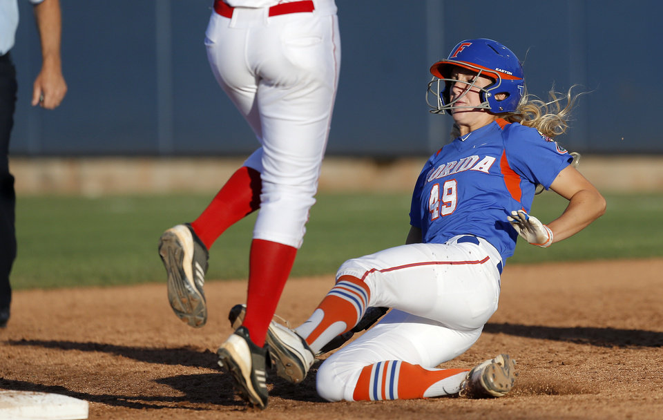 Florida's Taylor Schwarz is forced out at second base in the fifth inning of a Women's College World Series softball game between Nebraska and Florida at ASA Hall of Fame Stadium in Oklahoma City, Saturday, June, 1, 2013. Photo by Bryan Terry, The Oklahoman