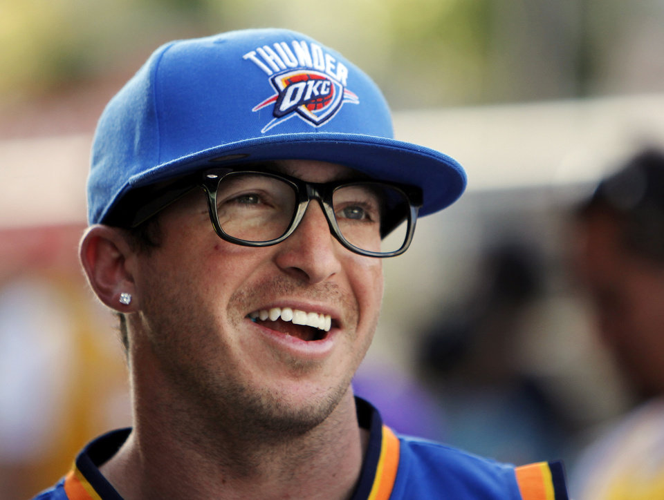 Photo - Thunder fan Ryan Brosnan, of San Diego, wears glasses with no lenses in the style of Russell Westbrook while waiting outside the Staples Center before Game 4 in the second round of the NBA basketball playoffs between the L.A. Lakers and the Oklahoma City Thunder at the Staples Center in Los Angeles, Saturday, May 19, 2012. Brosnan became a Thunder fan while attending Southern Nazarene University. Photo by Nate Billings, The Oklahoman