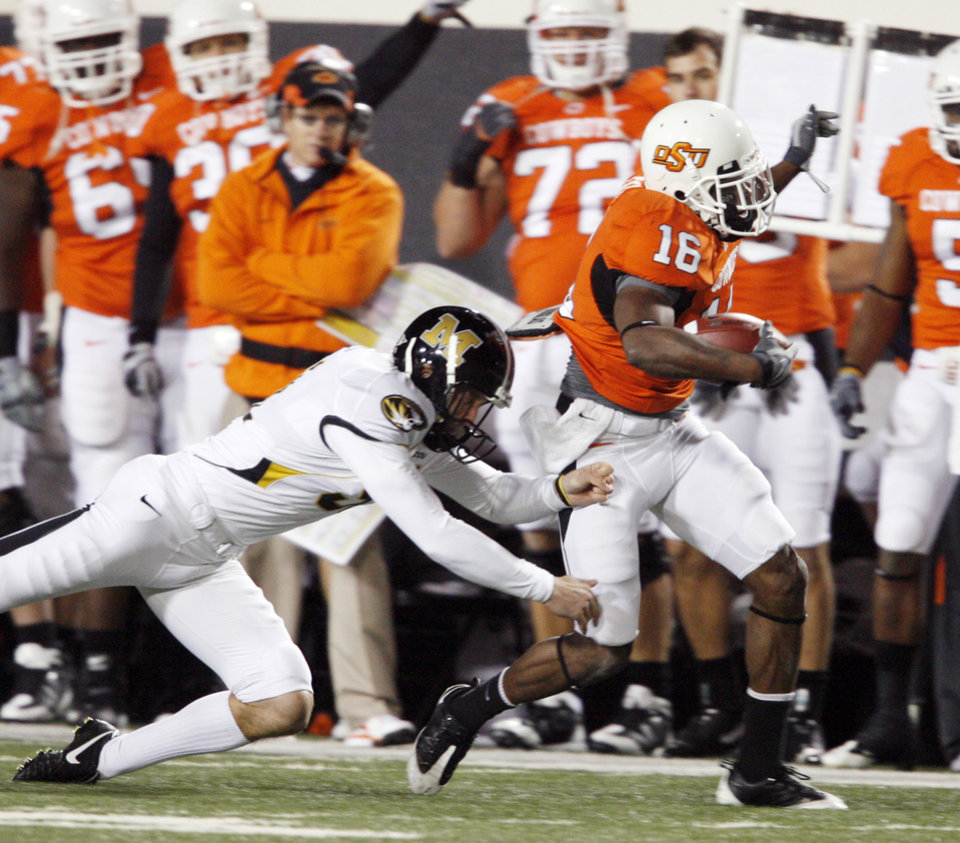 Photo - Perrish Cox gets a long return on a kick during the college football game between Oklahoma State University (OSU) and the University of Missouri (MU) at Boone Pickens Stadium in Stillwater, Okla. Saturday, Oct. 17, 2009.  Photo by Steve Sisney, The Oklahoman