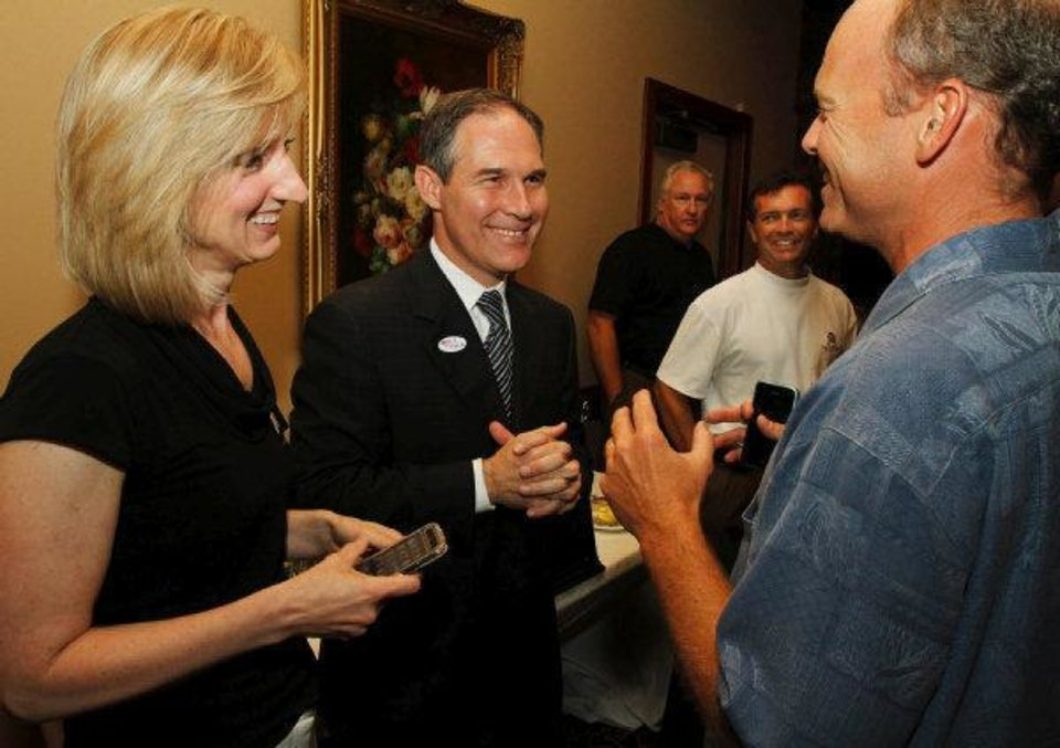 Republican candidate for Attorney General Scott Pruitt (middle) jokes with his campaign consultants Laurie Spiez and Terry Allen during his watch party at the Cedar Ridge Country Club in Tulsa, Okla., on July 27,2010. JAMES GIBBARD/Tulsa World ORG XMIT: DTI1007272128492546