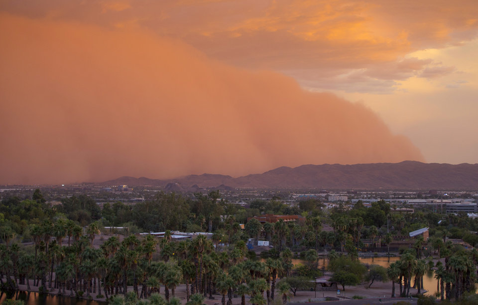 Photo - A dust storm moves through Phoenix, Thursday, July 3, 2014. (AP Photo/The Arizona Republic, Patrick Breen)  MARICOPA COUNTY OUT; MAGS OUT; NO SALES