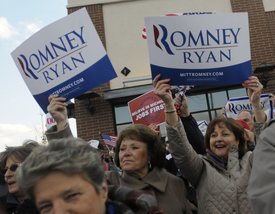 Photo -   Supporters of GOP presidential candidate Mitt Romney wave signs during a rally featuring Romney's son, Matt Romney, outside Romney's Victory headquarters in Livonia, Mich., on Monday, Nov. 5, 2012. (AP Photo/The Detroit News, Elizabeth Conley)