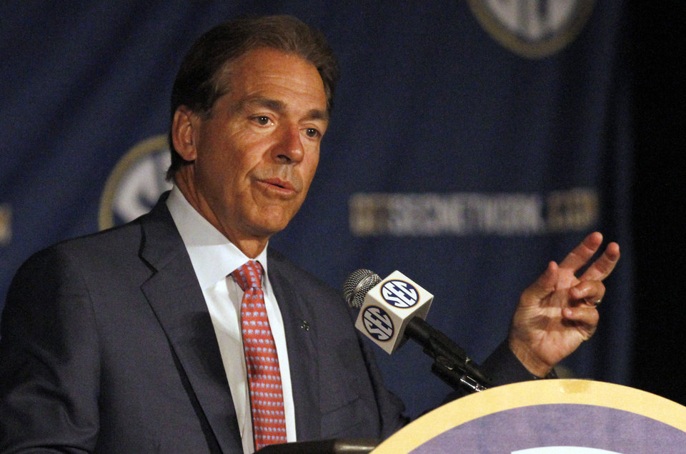 Photo - Alabama coach Nick Saban speaks to the media at the Southeastern Conference NCAA college football media days Thursday, July 17, 2014, in Hoover, Ala. (AP Photo/Butch Dill)