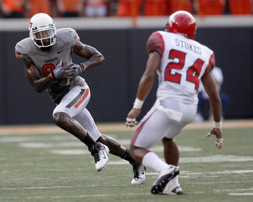 Oklahoma State's Justin Blackmon tries to get by Louisiana-Lafayette's Lionel Stokes (24) during their game Saturday. Photo by Sarah Phipps, The Oklahoman