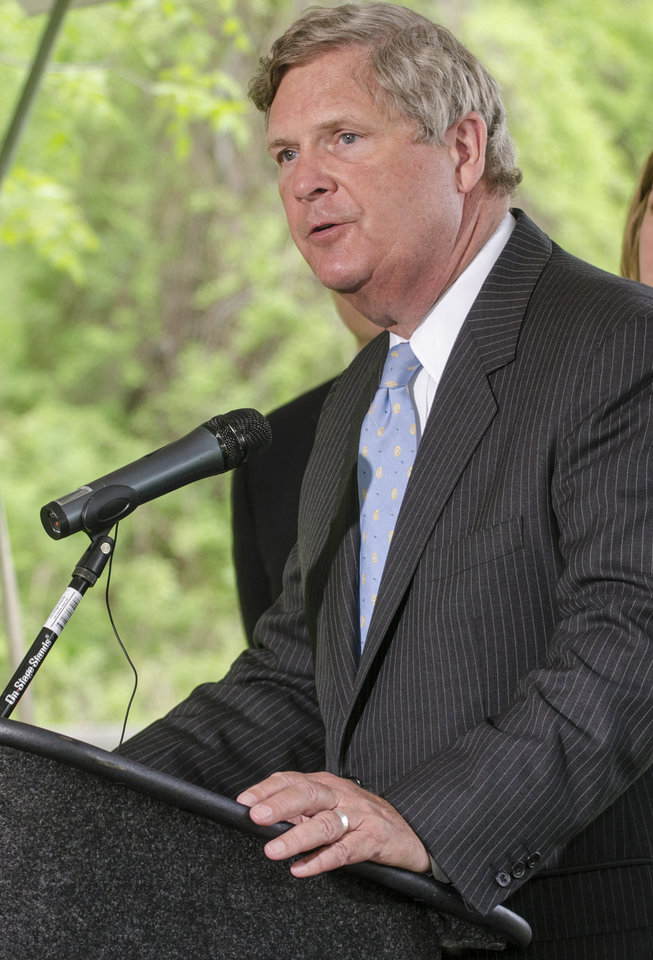 Photo - U.S. Secretary of Agriculture Tom Vilsack speaks about a new conservation plan during a press conference at the Bay City State Recreation Area in Bangor Township on Tuesday, May 27, 2014. The U.S. Department of Agriculture is teaming with businesses, nonprofits and others on a five-year, $2.4 billion program that will fund locally designed soil and water conservation projects nationwide, Agriculture Secretary Tom Vilsack said.    (AP Photo/The Bay City Times, Danielle McGrew)