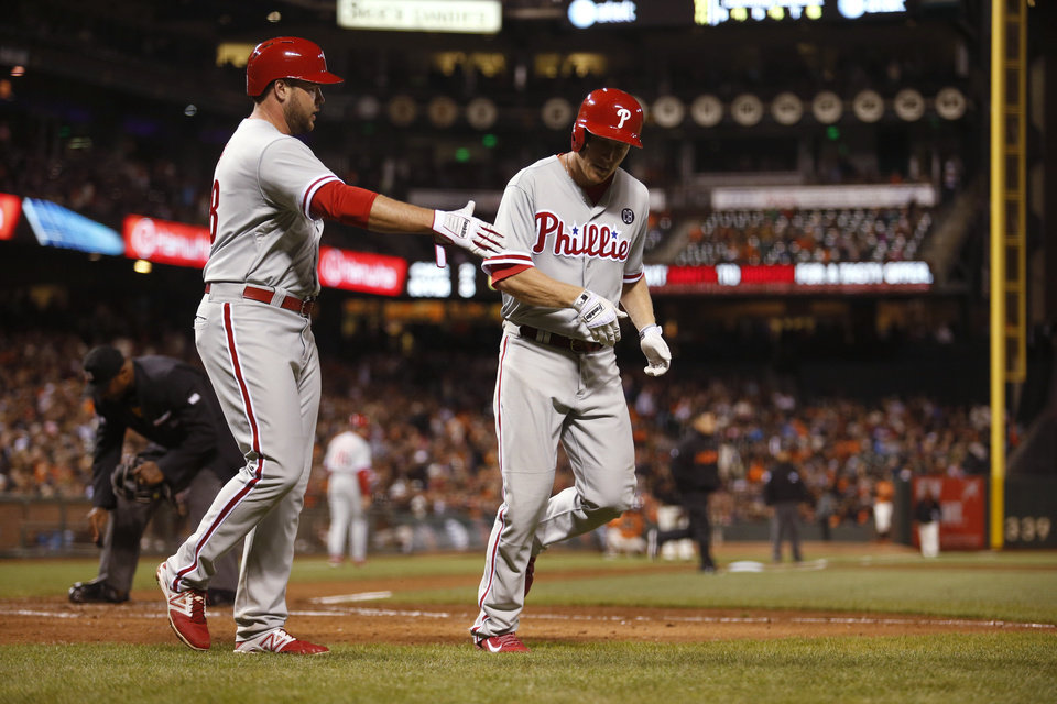 Photo - Philadelphia Phillies' Cody Asche, right, is congratulated by Darin Ruf after Asche hit a two-run home run during the eighth inning of a baseball game against the San Francisco Giants, Friday Aug. 15, 2014, in San Francisco. (AP Photo/Beck Diefenbach)