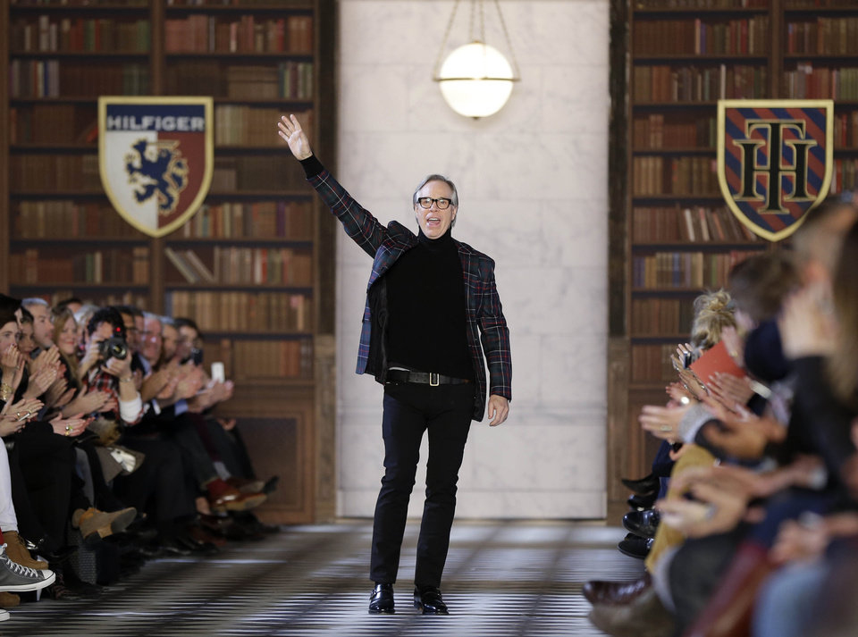 Photo - Tommy Hilfiger greets the crowd after showing his Fall 2013 collection during Fashion Week in New York, Sunday, Feb. 10, 2013.  (AP Photo/Seth Wenig)